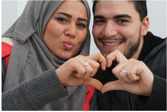 Muslims making a love heart sign together